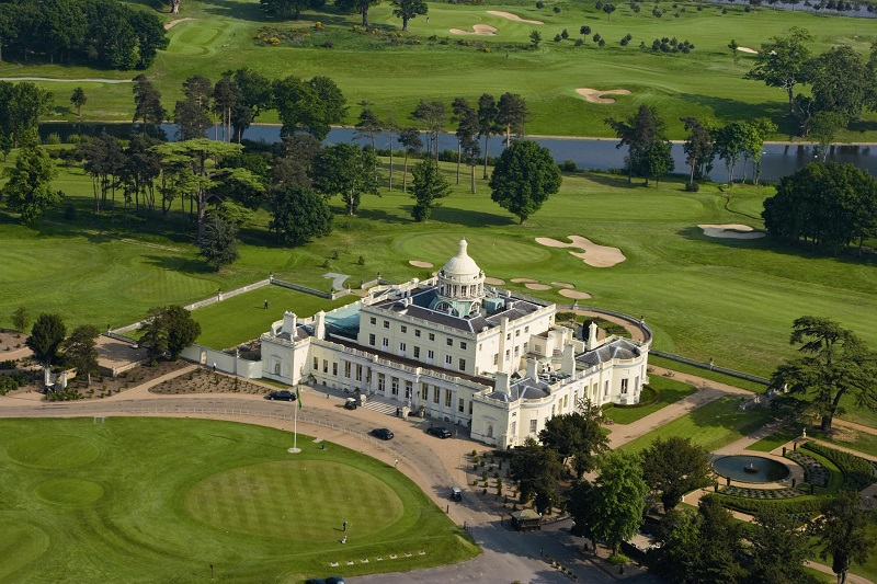 STOKE PARK CLUB during spring. Aerial of golf course / clubhouse and pavillion.